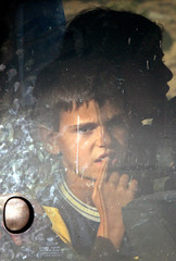 A Lebanese boy waits in a bus at the Syrian border crossing post of Jdeideh