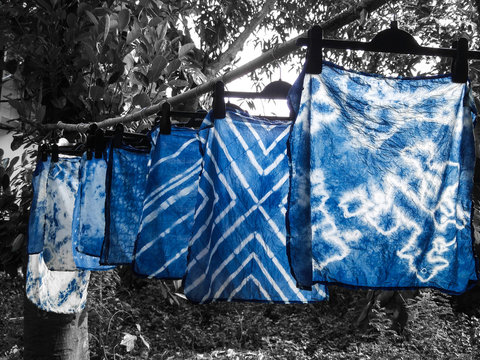 Beautiful natural indigo tie dye fabric with black and white background.