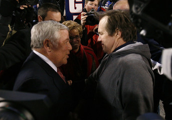 Patriots head coach Belichick shakes hands with team owner Craft after defeating Giants in their NFL football game in East Rutherford