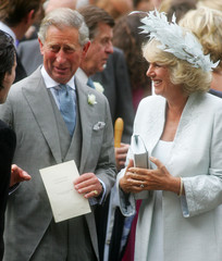 Prince Charles and his wife Camilla Duchess of Cornwall leave St Nicholas Church in Northfield Greys ...