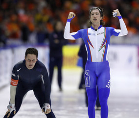 Fabris of Italy reacts after beating Hedrick of the U.S. In the men's 5000 meters at the World Cup speedskating race in Heerenveen