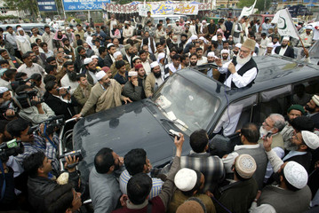 Head of Pakistan's six party Islamic alliance Ahmed speaks during an anti-government protest rally ...