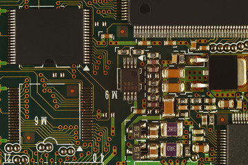 Electronic circuit board with digital microchips close up.
