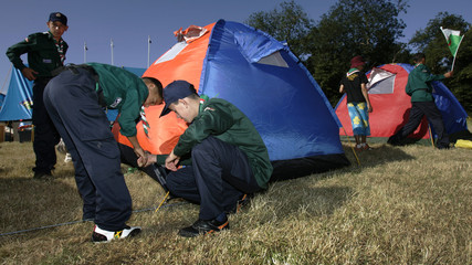 Scouts from Algeria put up tents at the 21st World Scout Jamboree at Highlands Park near Chelmsford in south-eastern England