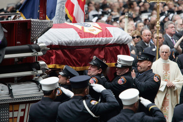 The casket of FDNY firefighter Robert Beddia is placed aboard a fire engine outside St. Patrick's Cathedral after his funeral in New York