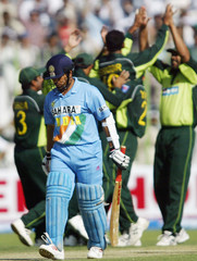 PAKISTANI PLAYERS CELEBRATE AFTER THE DISMISSAL OF TENDULKAR IN PESHAWAR.