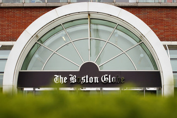 Boston Globe's logo is seen at entrance of newspaper's building in Boston