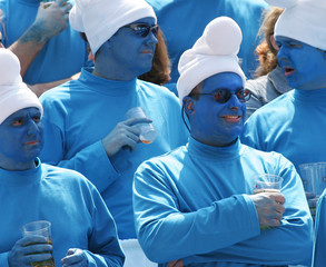 """Fans dressed as Fans dressed as U.S. cartoon characters """"Smurf"""" watch a match during the second day ..."""