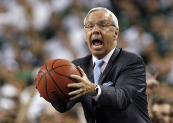 North Carolina Tar Heels head coach Williams catches a ball during his team's game against the Michigan State Spartans at the NCAA men's Final Four championship in Detroit