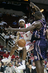 Houston Rockets guard Aaron Brooks makes an outlet pass past New Jersey Nets center DeSagana Diop in the second half of their NBA game in Houston