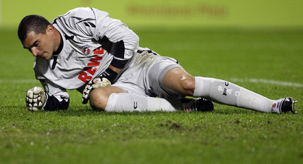 Cologne's goalkeeper Mondragon lies on the pitch during their German Soccer Cup match against Mainz in Mainz