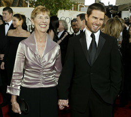 Actor Tom Cruise (R) arrives with his mother Mary Lee Mapother for the 61st annual Golden Globe Awar..