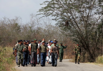 Venezuelan territorial guard volunteers arrive for training at a rural military base on the outskirt..