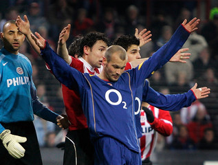 Arsenal's Ljungberg and PSV Eindhoven's van Bommel react during their Champions League Group E ...