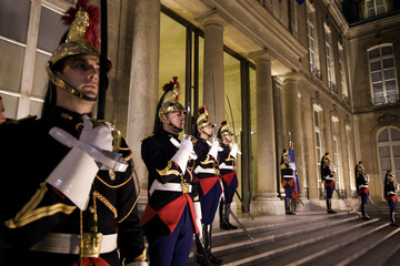 Republican guards stand outside the Elysee Palace in Paris
