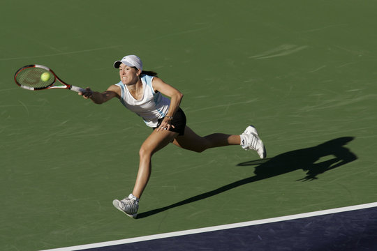 Justine Henin-Hardenne lunges for a forehand during a workout at the Pacific Life Open in Indian Wells