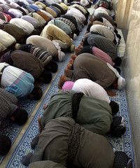 Iraqi worshippers pray during the Friday prayers at the Sheik abdu al-Qader  Mosque in Baghdad Octob..