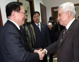 Palestinian leader Abbas greets China's State councillor Jiaxuan in Ramallah.