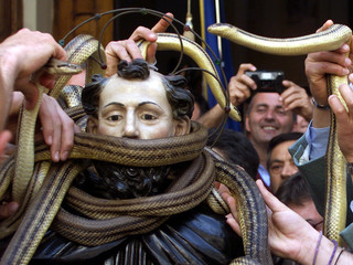 Snake-catchers put snakes onto the statue of St. Domenico at the beginning of St.Domenico's processi..