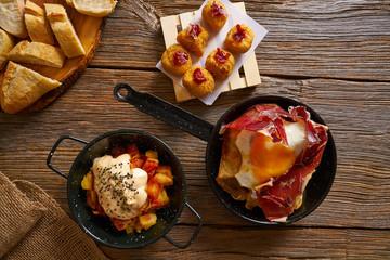 Tapas Spain broken eggs Croquettes bravas