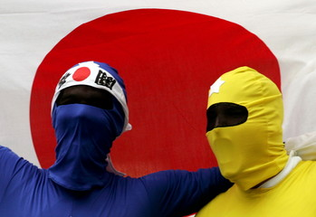 Fans dressed as Japanese cartoon figures the Power Rangers shout during the first day of the Rugby W..