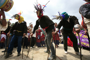 Men from the Tamang community perform a traditional dance while participating in a rally to mark World Indigenous Day in Kathmandu