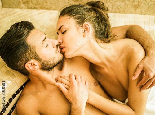 Young Couple Of Lovers Kissing In Turkish Steam Room Bath Stock