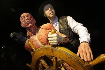 German anatomy professor von Hagens poses next to a plastinated human specimen during the presentation of the new Koerperwelten exhibition in Heidelberg