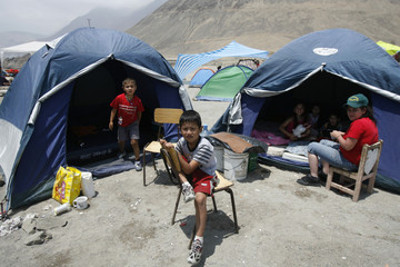 Earthquake victims wait at a shelter in Tocopilla