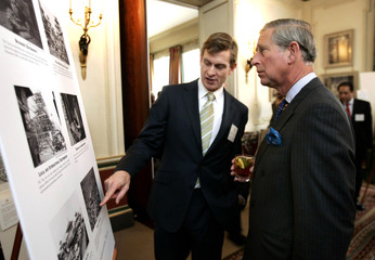 Britain's Prince Charles listens to Theophile, Chief Executive of the Kathmandu Valley Preservation Trust, during reception at Clarence House in London