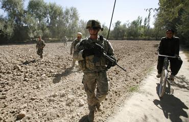 Lieutenant Babington leads a joint foot patrol in Logar province