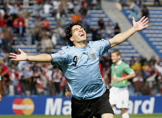Uruguay's Luis Suarez celebrates after he scored a goal during their 2010 World Cup qualifying soccer match against Bolivia in Montevideo