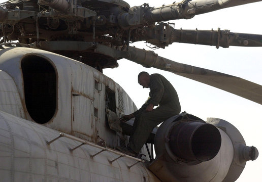 US MARINE AIRCRAFT MECHANIC WORKS ON HELICOPTER AT SOUTHERN AFGHANISTANBASE.