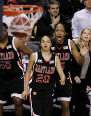 Maryland's Perry, Toliver and Harper watch Toliver's three pointer put game against Duke into overtime during Women's NCAA Final Four basketball championship game in Boston
