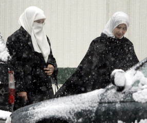 The Mother of Ahmed Omar Abu Ali, Faten Abu Ali walks to the D.C. District Court in Washington.