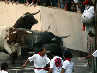 FIGHTING BULLS CRASH INTO A BARRIER DURING THE 7TH BULL RUN OF THE SANFERMIN FESTIVAL IN PAMPLONA.