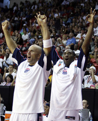 Team USA's Kobe Bryant and Jason Kidd celebrate a USA basket against Puerto Ricoduring the FIBA Americas regional qualifying basketball tournament in Las Vegas