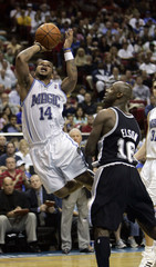 Magic guard Jameer Nelson is fouled by San Antonio Spurs center Francisco Elson during second half NBA basketball action in Orlando