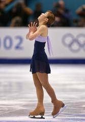 JAPANESE SUGURI PERFORMS FREE SKATING PROGRAM AT WINTER OLYMPICS.