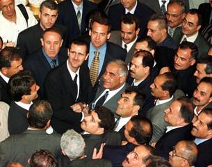 BASHAR AL-ASSAD ESCORTED BY BAATH PARTY CONGRESS.