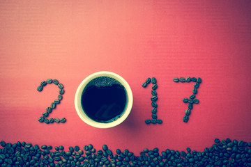 2017 coffee bean text on red craft paper for new year concept background