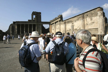 Visitors walk in Pompeii, the famous city next to Naples, which is destroyed in AD 79 by the eruption of Mount Vesuvius