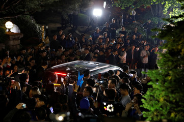 A vehicle carrying South Korea's president-elect Moon Jae-in leaves his house to meet supporters at Gwanghwamun Square in Seoul