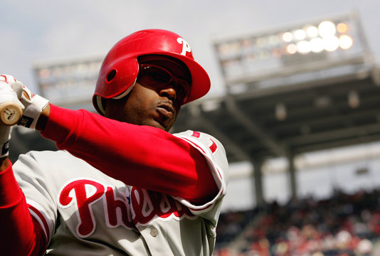 Philadelphia Phillies lead off batter Jimmy Rollins warms up in the on deck circle during their MLB baseball game in Washington