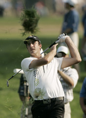 Geoff Ogilvy hits out of rough on the 12th hole during final round of 106th US Open in Mamaroneck