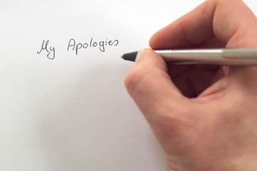 My Apologies in handwriting by hand with pen on white paper