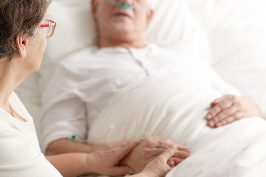 Wife caring about dying spouse