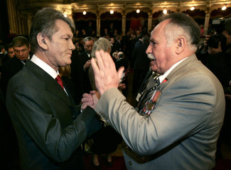 Ukraines President Viktor Yushchenko shakes hands with a former Red Army soldier at the Slowacki ...
