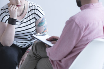 Addiction counselor talking with girl