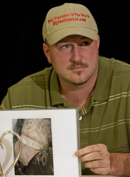 Rick Dyer, 31, holds a picture he claims is the mouth of Bigfoot in Palo Alto